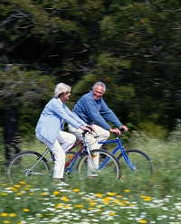 Elderly couple riding bikes. The Many Benefits of Preventive Cardiology, HealthFlash Blog, Stamford Health
