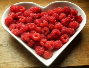 Raspberries in a heart bowl