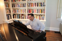 Michael Coady, MD, Chief of Cardiac Surgery at Stamford Hospital, playing piano