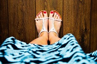 A pair of feet in sandals. Beware of bunions.