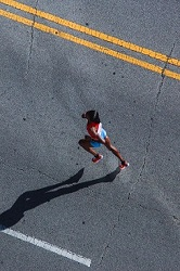 "Runner racing on road, ""Tips for Road Race Season""- Dr. Robert Weiss, Blog"