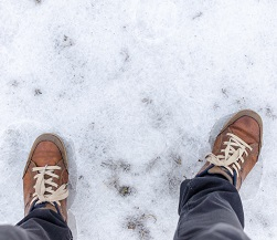 Pair of feet on ice. Cold Weather Injuries, Robert F. Weiss, Podiatry