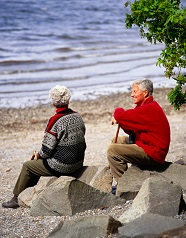 Elderly couple on a beach. Osteoporosis Center blog, Stamford Health