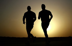 two men running outside. running safely in the winter. robert f. weiss, stamford health medical group
