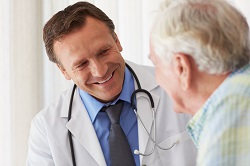 Male Doctor and Senior Male Patient: Colorectal Cancer: Risk Factors and Symptoms