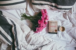 Empty bed with flowers. 3 Tips for Better Sex After Menopause