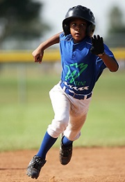 Young baseball player running. Athletic Injuries in Children- Blog by Scott Weiss, DPM, Stamford Health Medical Group