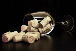 Wine glass and corks