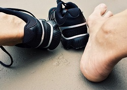 Pair of feet with athletic shoes. Stress Fractures: Not Just for Athletes