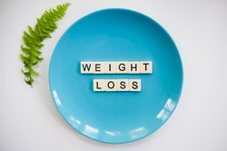 Weight Loss written on blue plate